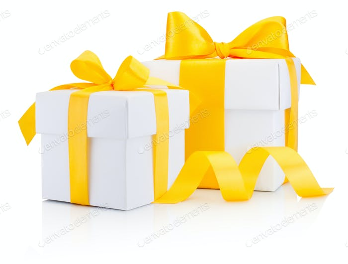 Two white gift boxes tied a yellow ribbon bow Isolated on white