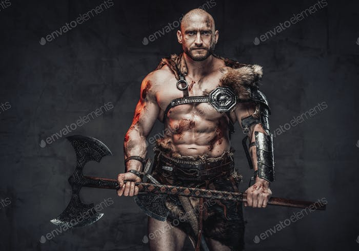 Powerful and bald viking holding huge axe in dark background