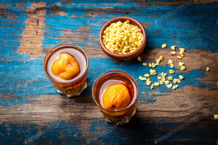 Mote con huesillo. Traditional Chilean drink made from cooked husked wheat and dried peach