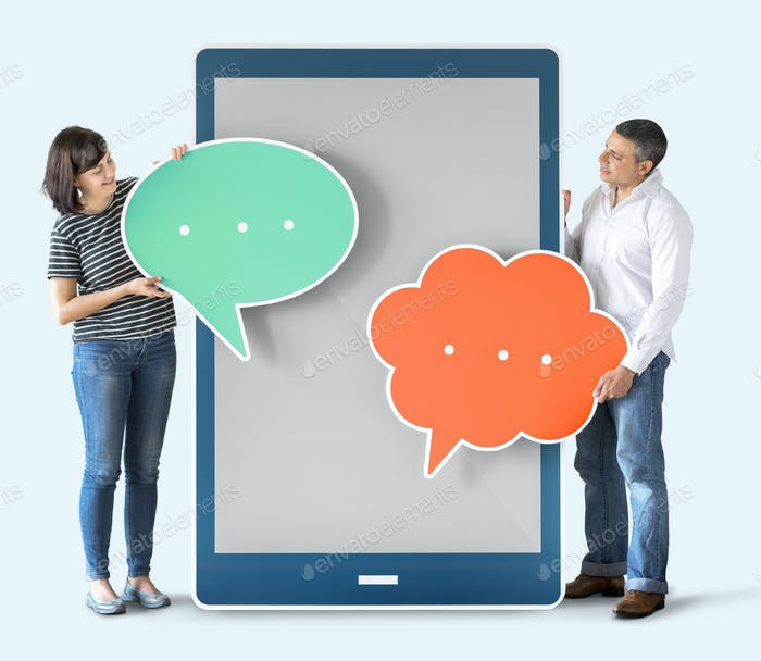 Diverse people holding speech bubbles and tablet