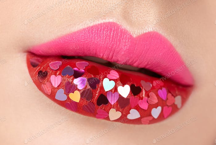 Beautiful plump pink lips with pasted hearts