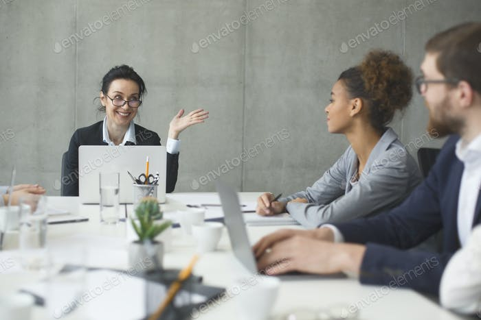 Business people brainstorming together in the meeting room