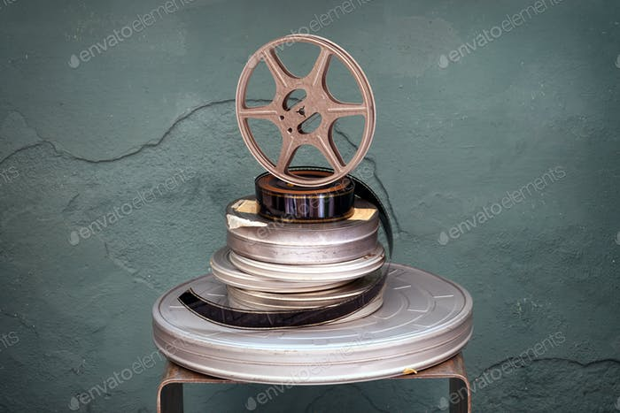 Old stacked vintage movie films and reel