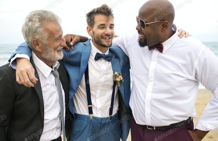 Groom talking to his groomsmen