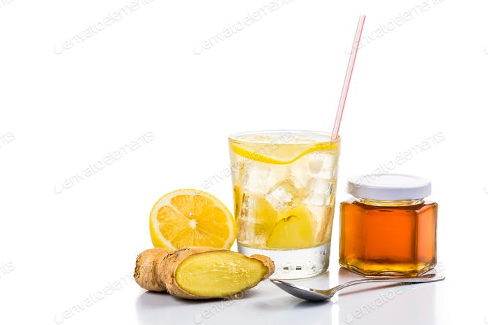 Refreshing ice cold honey lemon and ginger tea in transparent glass