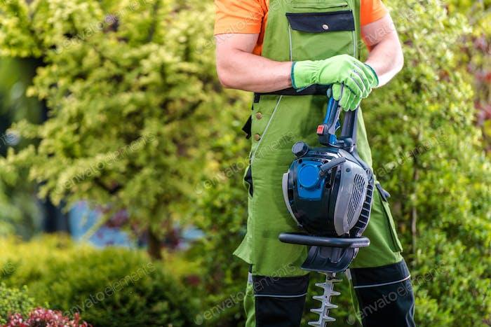 Gardener with Gasoline Trimmer