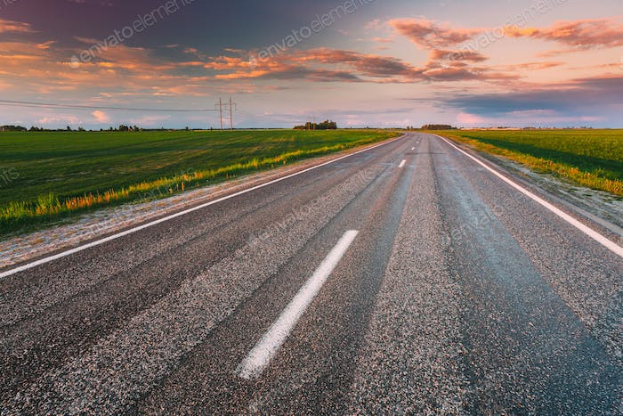 Asphalt Country Open Road Through Spring Fields And Meadows In Sunny Evening. Landscape In Early
