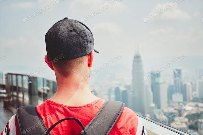Traveler in modern city