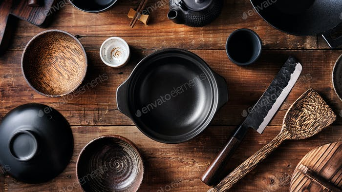 Set of dishes for Asian cuisine, pot, bowls, wok, Japanese knife