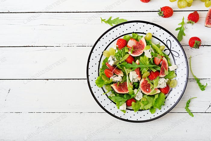 Easy vegetarian salad with figs, strawberries, grapes, blue cheese