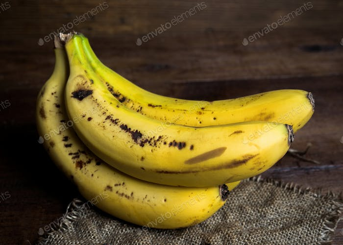 bananas on canvas and wooden board