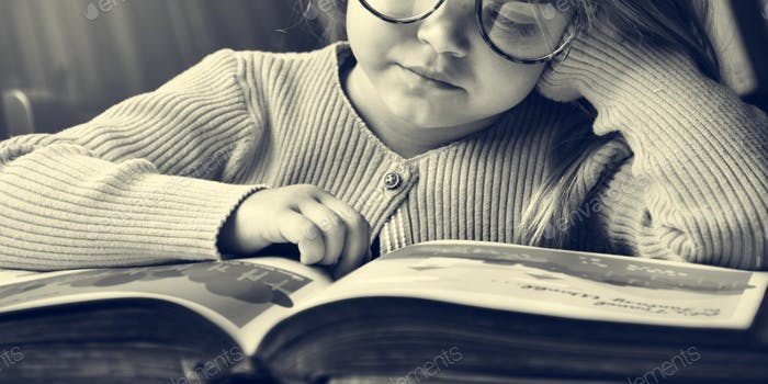 Adorable Cute Girl Reading Storytelling Concept