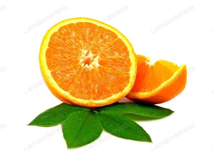 Fresh oranges on leaves