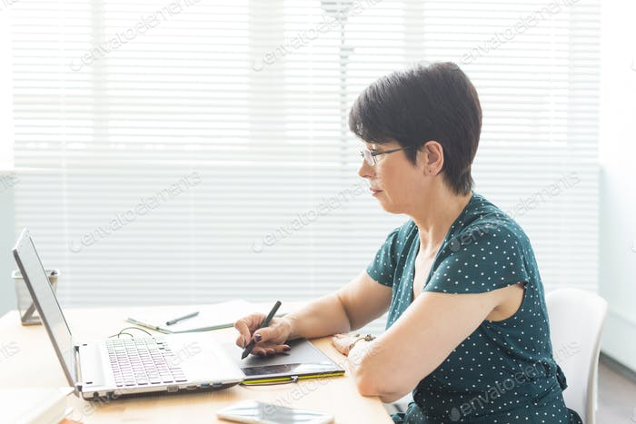People and graphic designer concept - Middle age woman concentrated working at the office