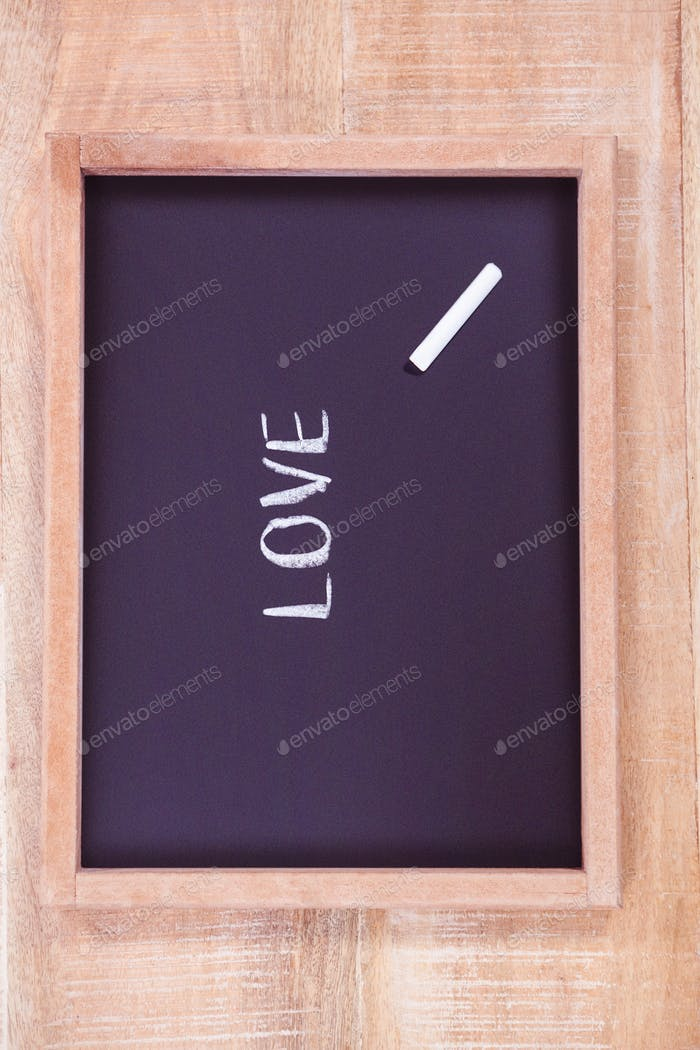 Chalkboard with love text on desk