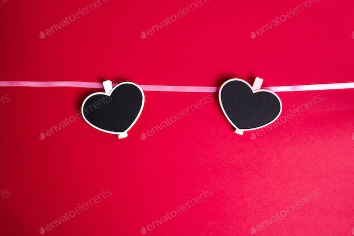 Love for Valentine's day - Red hearts hung together