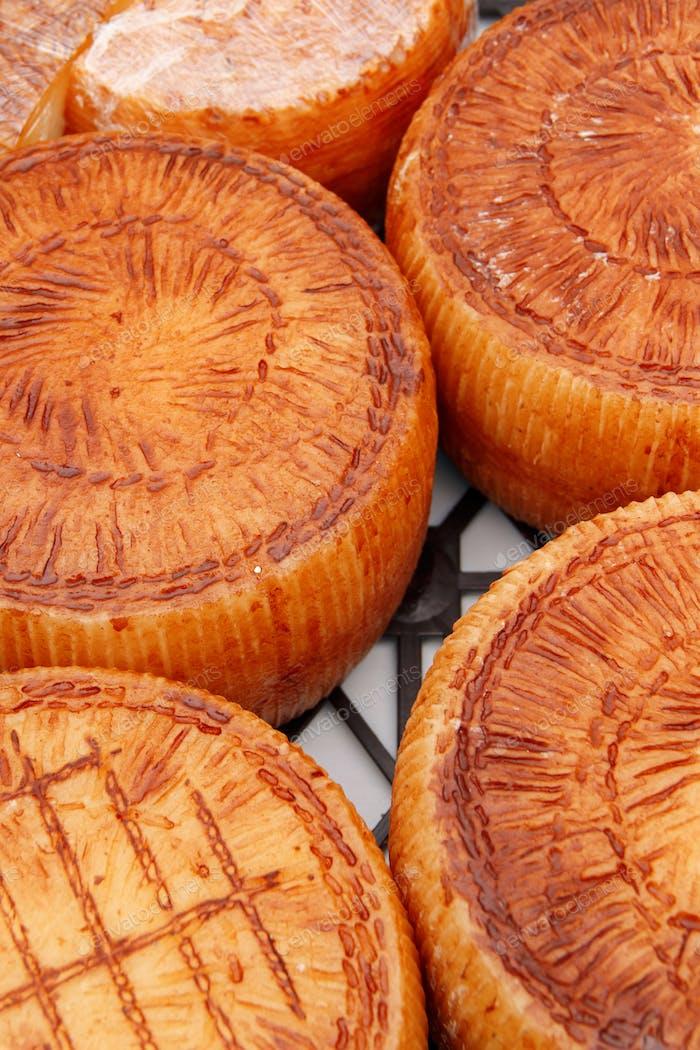 Cheese wheels on a local farmers market