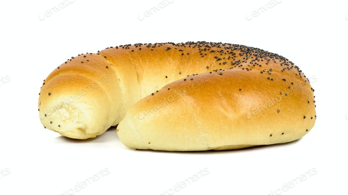 Crescent roll with poppy seeds on white background