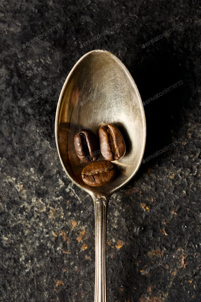 coffee beans in spoon