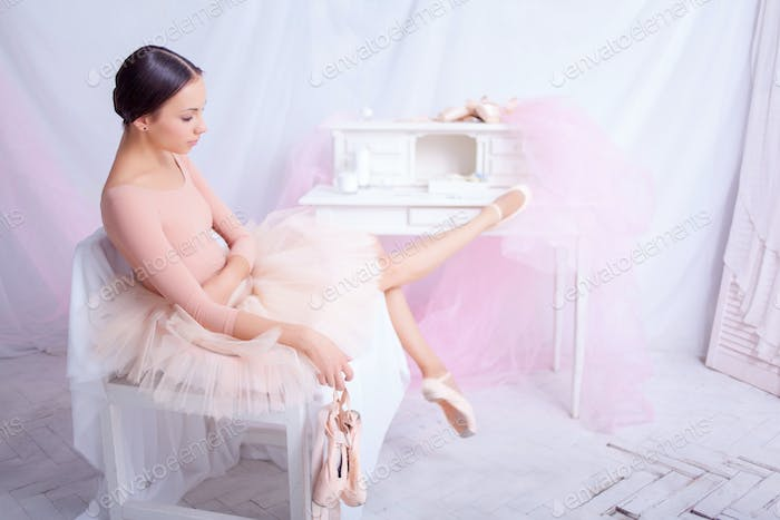 Professional ballet dancer resting after the performance.