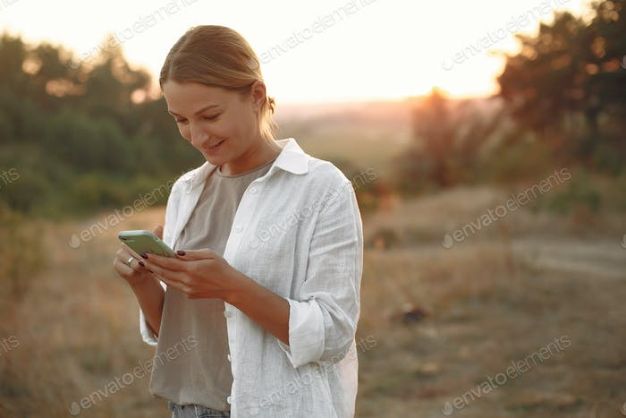 Beautiful elegant woman in a autumn wheat field