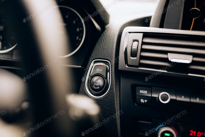 Car ignition detail - hybrid car with modern technology equipment
