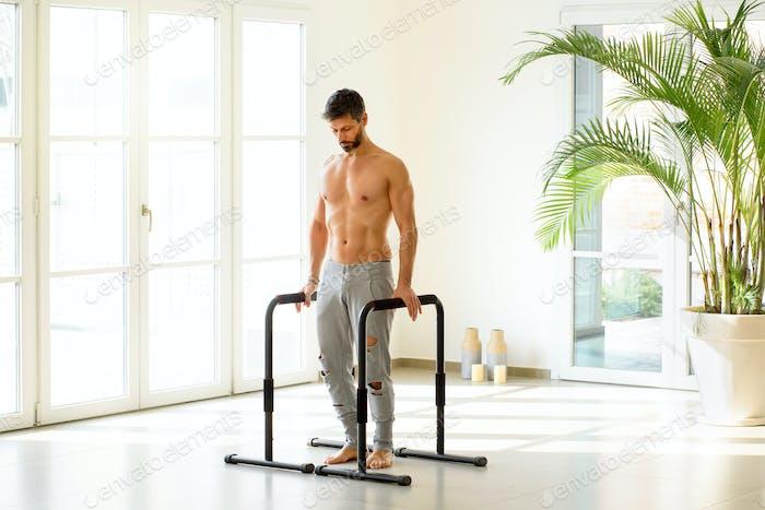 Muscular athlete ready for calisthenics exercise