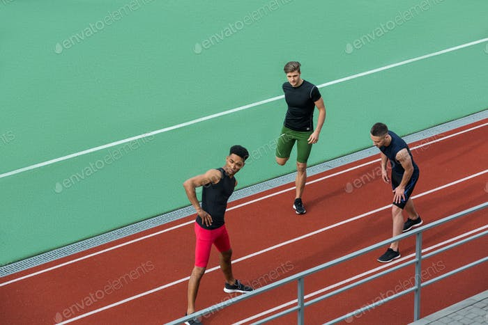 Young multiethnic athlete group make stretching exercises