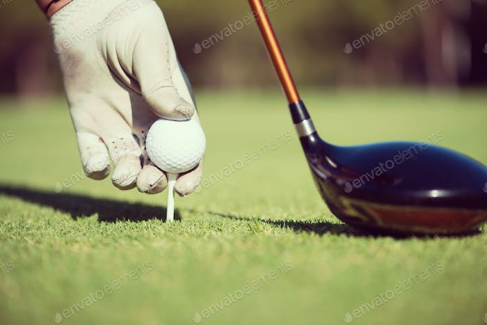 Thumbnail for golf player placing ball on tee