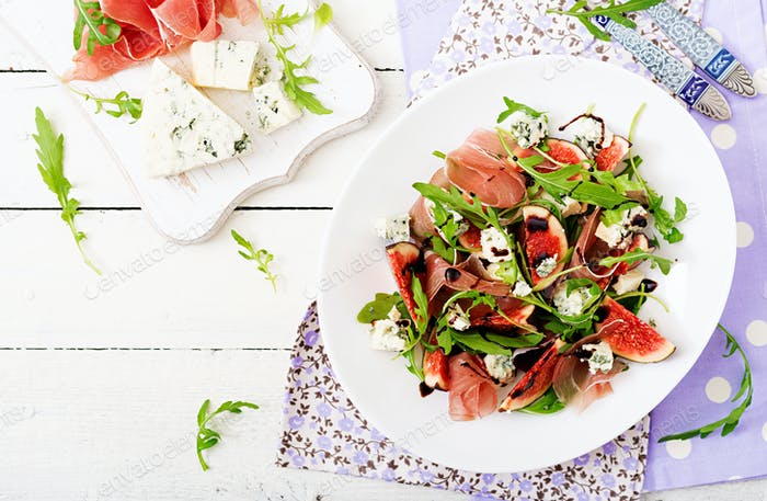 Prosciutto di Parma salad with figs and blue cheese. Flat lay. Top view