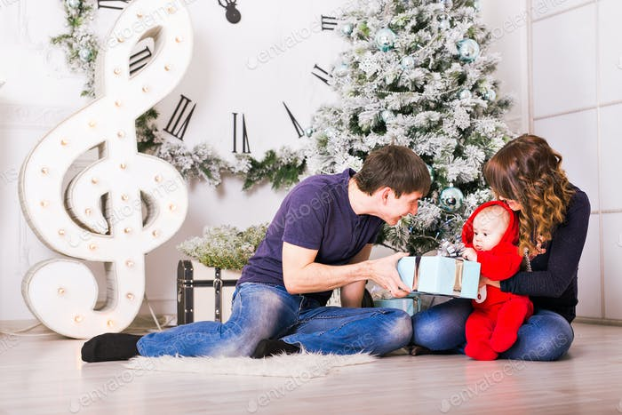 Christmas Family with baby opening gifts