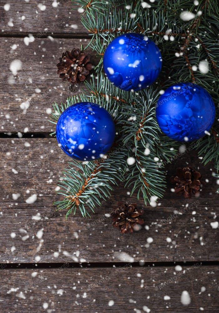 Blue Christmas balls and fir branch