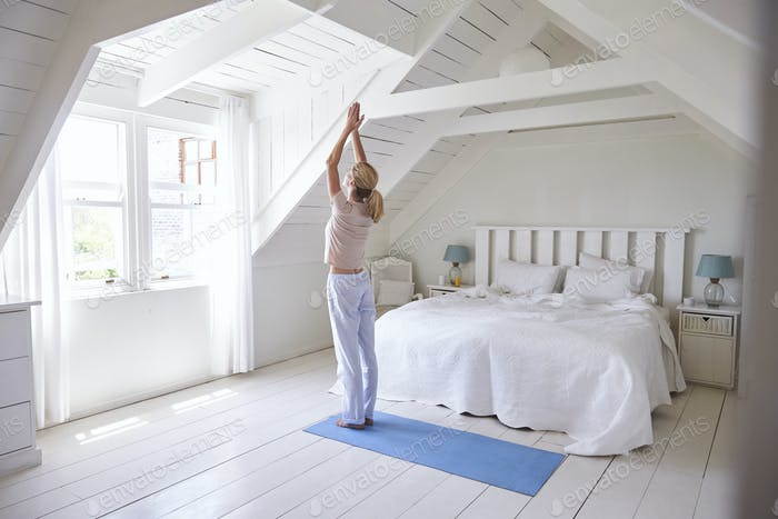 Woman At Home Starting Morning With Yoga Exercises In Bedroom Photo By Monkeybusiness On Envato Elements