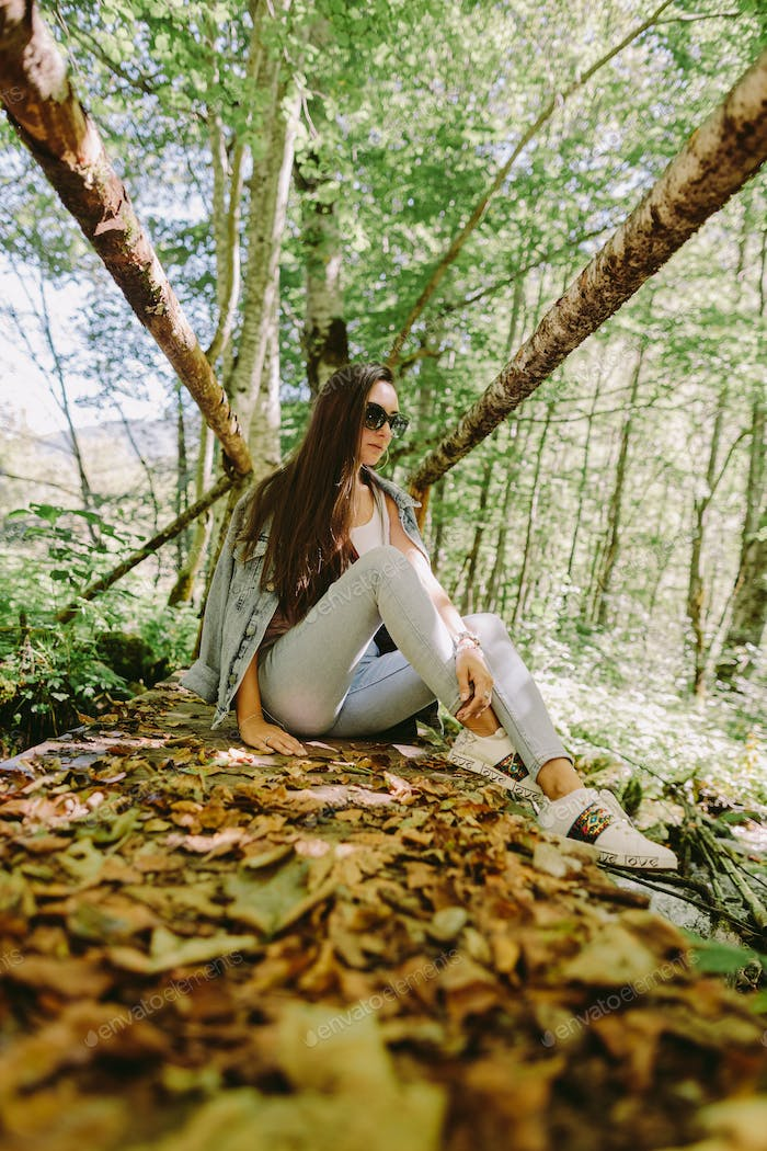 woman relax in autumn forest