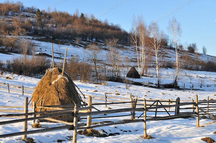 Haystacks and beautiful winter landscape