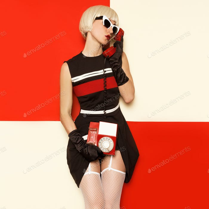 Sexy Retro Cabaret Style Blonde in vintage clothes and retro tel