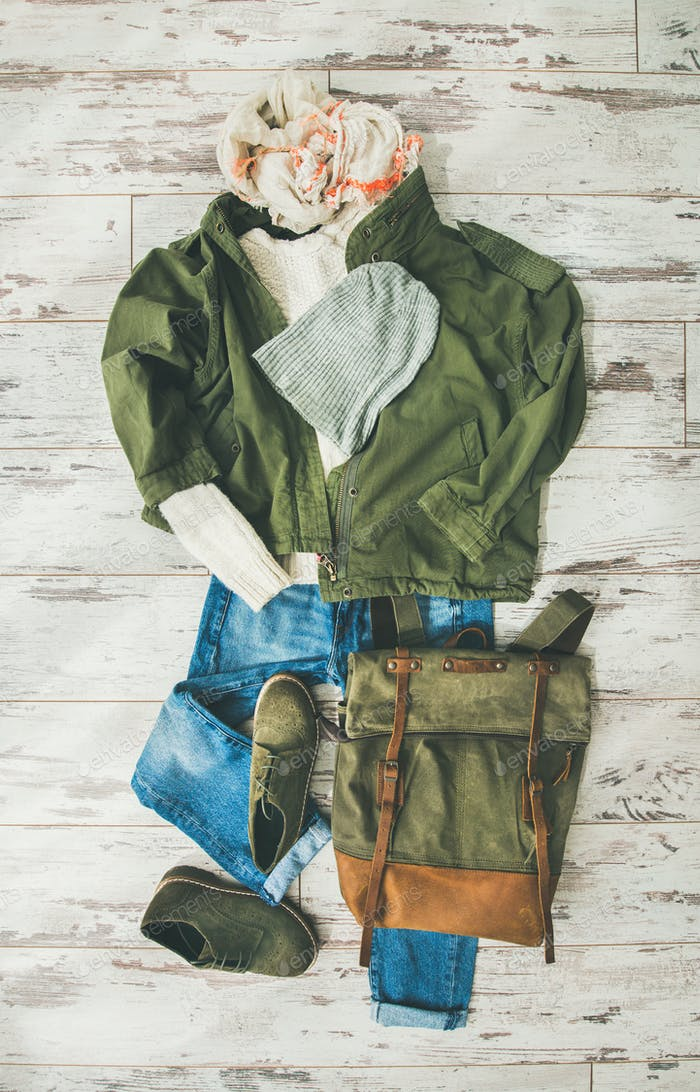 Flat-lay of Fall lady' s clothes outfit on parquet background