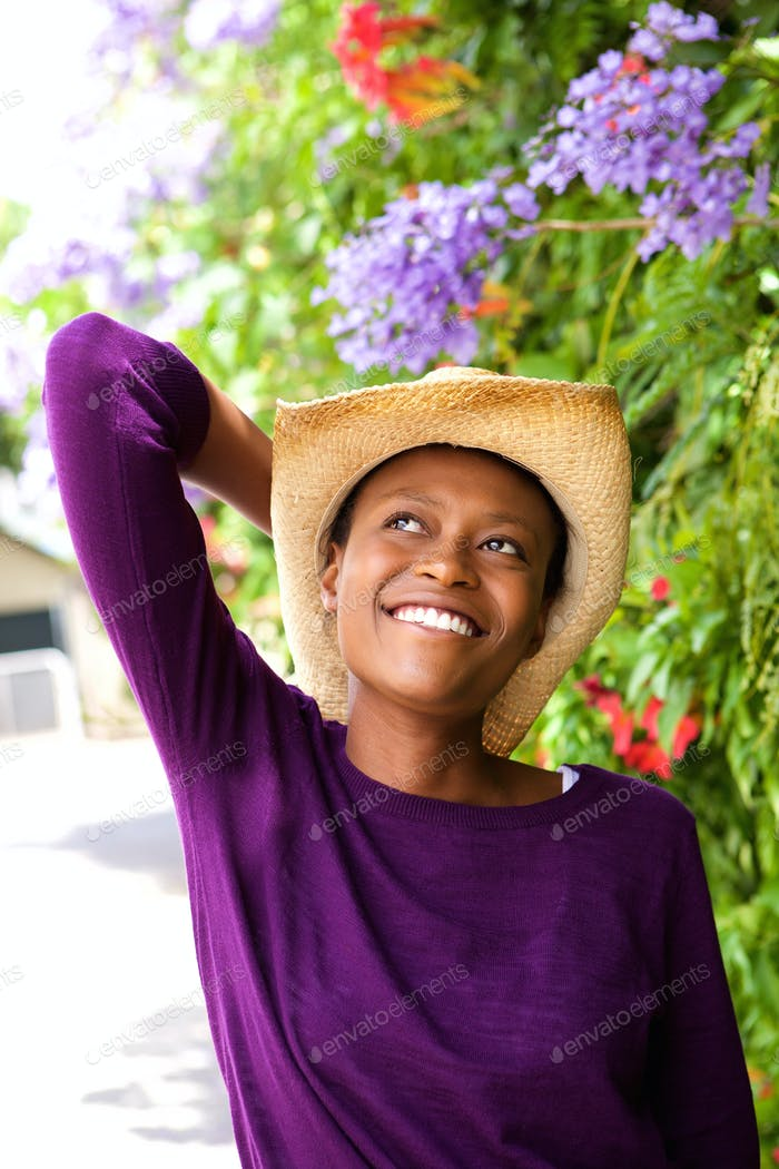 Beautiful young african woman with hat