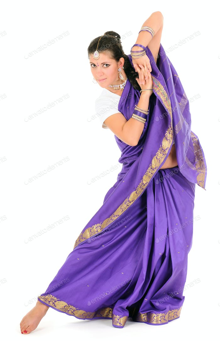 Woman posing in traditional purple indian clothes