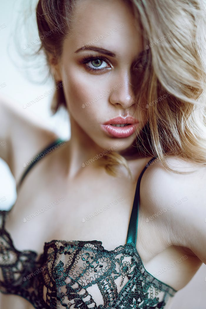 Fashionable female portrait of cute lady in green bra indoors