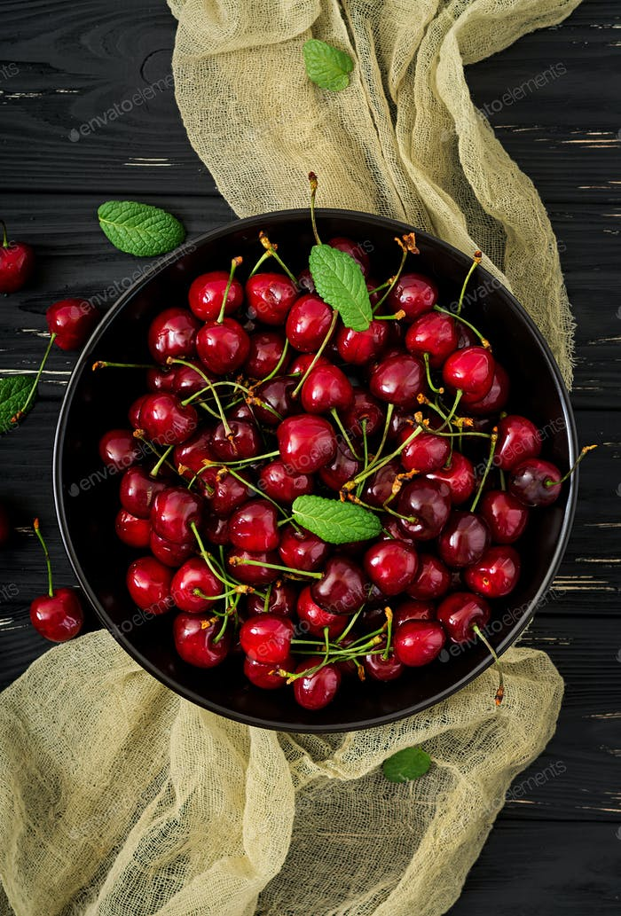 Ripe Sweet Cherry on a plate. Flat lay. Top view