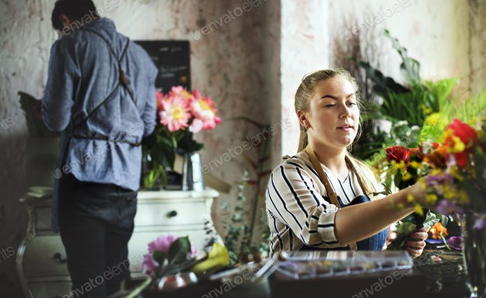 Flower shop business owner working service