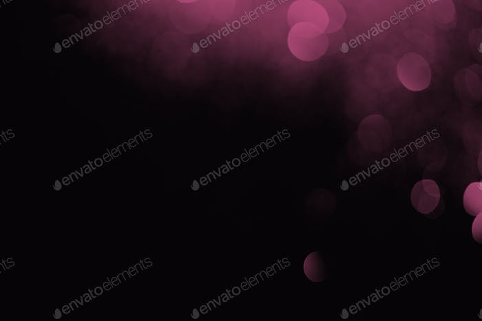 purple bokeh on black background for celebration
