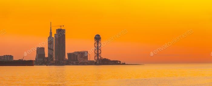 Batumi, Adjara, Georgia. Skyline Of Resort Town At Sunset Sunrise. Bright Orange Evening Sky. View