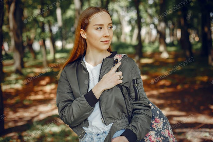 Elegant and stylish girl in a summer forest