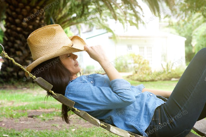 Beautiful woman relaxing in garden