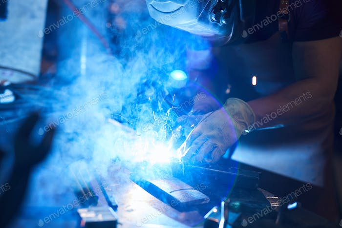 Joining metal pieces with welding torch