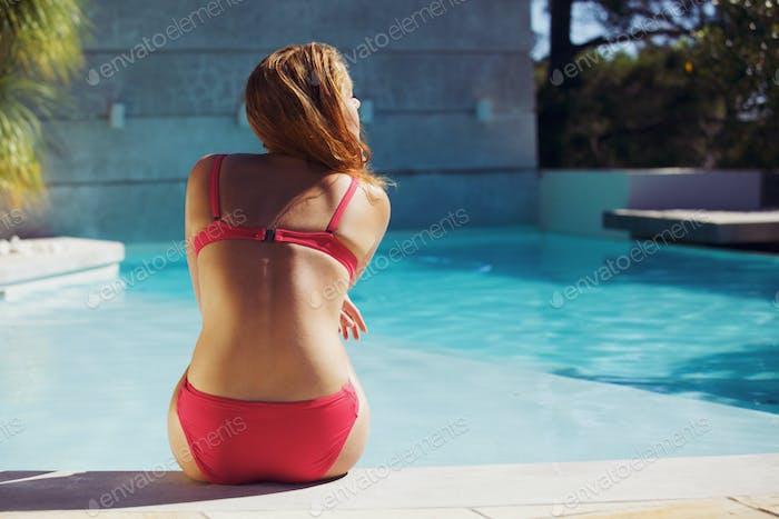 Young woman enjoying summer at the swimming pool