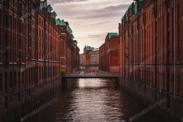 Speicherstadt warehouse district in Hamburg, Germany. Old brick buildings and channel of Hafencity