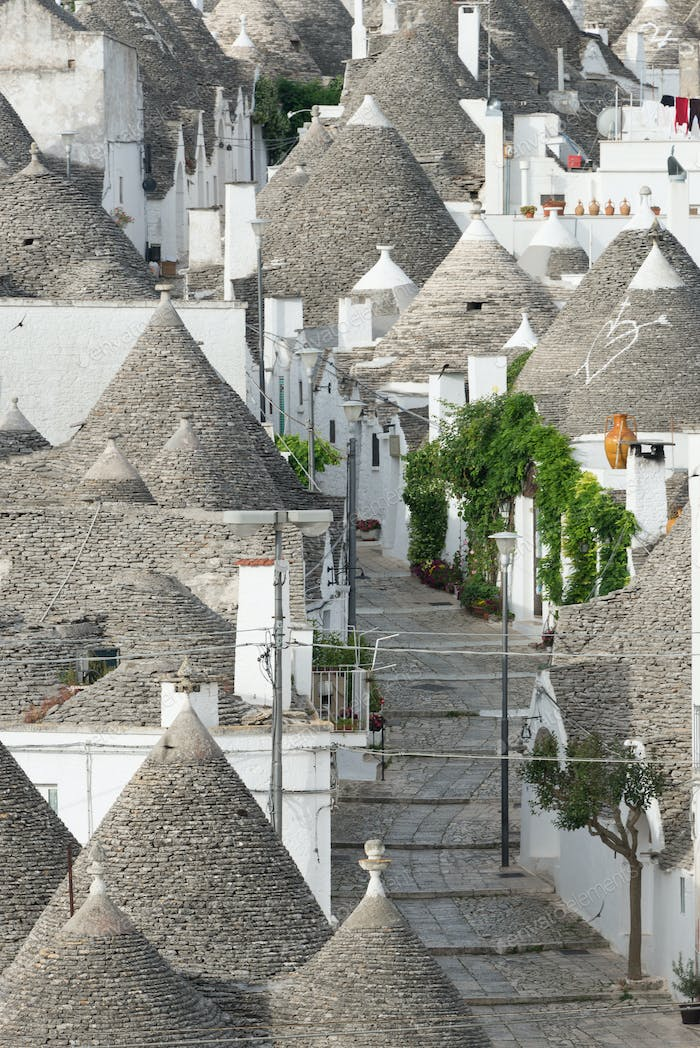 Street along trulli houses in Alberobello